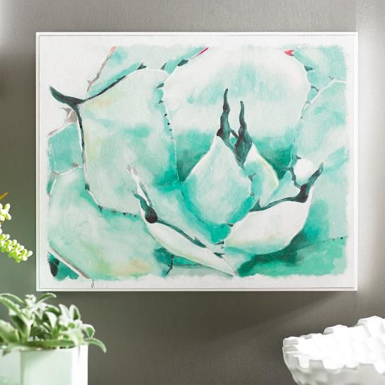 Our dreamy watercolor Succulent Wall Art takes you into the heart of this blue desert bloom to evoke all the wonders of a vibrant southwestern landscape, from distinct, dark edges to its smoky-hued colors. A light texture on the print adds just a touch of dimension, and a crisp white inverted frame fits snuggly around the art, flush with the its face, for modern finish appeal. A classic floral motif in updated presentation.Watercolor print featuring a succulent blossom close-upLight texture…