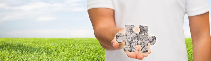 man holding puzzle over natural background