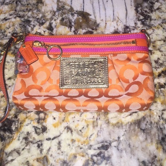 Coach poppy Wristlet Orange, pink and gold Coach Poppy Wristlet!  It features two zippered pockets - one smaller one and one larger.  Gently used.  The last photograph shows you an example of the few discolorations/spots that are noticeable.  You could try cleaning them with a fabric cleaner! The inside is a beautiful pink with few spots, but some discolorations. Fun colors for spring and summer!! Coach Bags Clutches & Wristlets