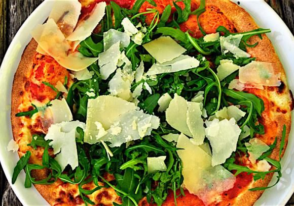 The contrast between a hot, crispy crust and a cool, leafy salad makes this easy pizza seem much more complicated than it is. Great in summer, or anytime you want a quick, fresh meal.