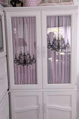 Repurpose my china cabinet as an armoire.  Put sheers inside doors.