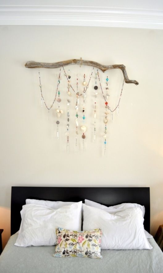 drift wood, seed bead chains to drape over then a few beaded cords with shells, gems, feathers, glass and plastic beads, colourful pebbles etc...