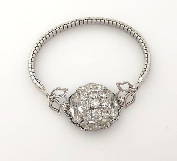 Repurposed clear vintage rhinestone swirl and silver tone stetch watchband bracelet