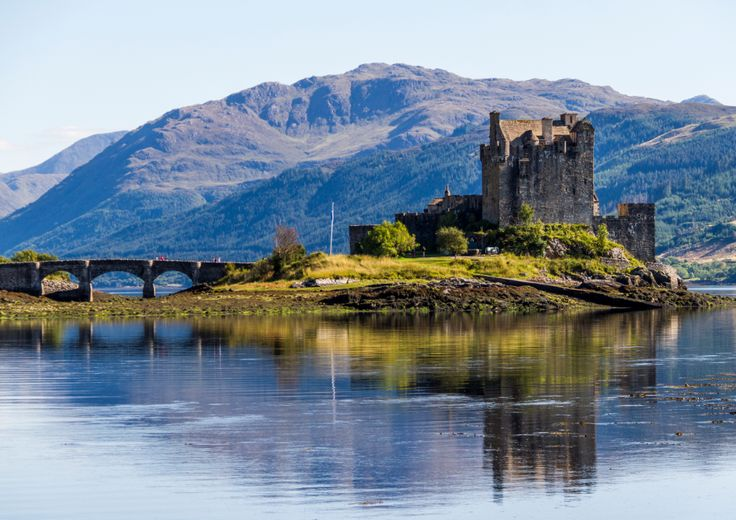 en-omgb:  A journey through time Eilean Donan Castle, Kyle of Lochalsh, Scotland This beautiful 13th century castle sits at the point where 3 great sea lochs meet and provides one of the most iconic images of Scotland. Photo by Colin Roberts - More info
