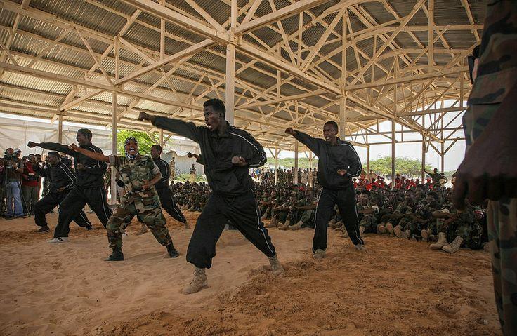 Recently trained members of the Somali National Army (SNA) demonstration self-defence techniques during a passing-out parade 14 August 2012, at an African Union Mission in Somalia (AMISOM) training facility on the western fringes of the Somali capital Mogadishu. AU-UN IST PHOTO / STUART PRICE.