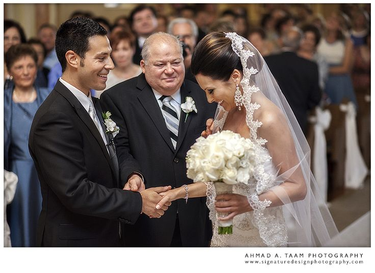 Father handing the bride over to the groom