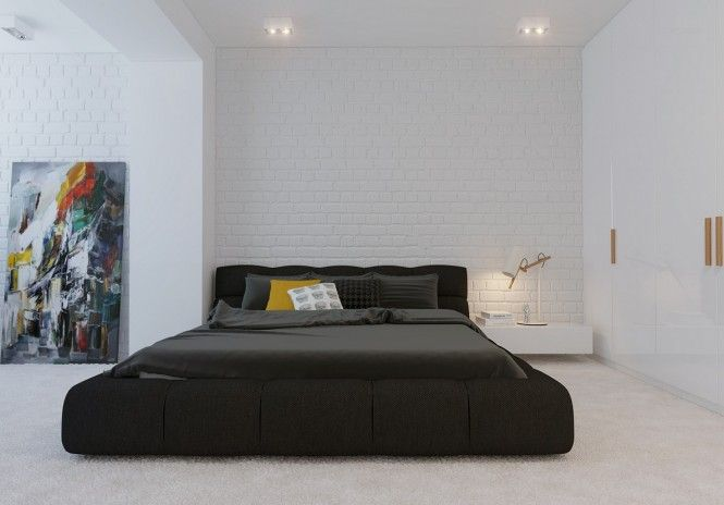 Let the walls and the furniture speak for themselves in this modern, minimalistic bedroom.