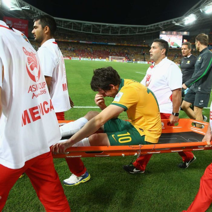 Kruse stretchered off in Asian Cup final - Robbie Kruse of Australia is taken off the ground with an injury during the 2015 Asian Cup final match against South Korea at Stadium Australia on January 31, 2015 in Sydney.