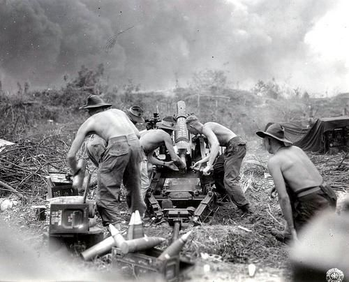 Australian gunners from the 4th Royal Australian Field Artillery Regiment, 7th Infantry Division, firing at Japanese positions from a shortened version of a British 25-pounder gun in the region of Balikpapan, on the island of Borneo, in the Dutch East Indies (future Indonesia).