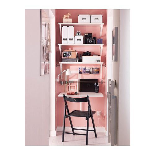 I have an empty wall and need for a workspace.  The desk at the bottom is actually a drop leaf, so it folds when not in use.  Brilliant!!    NORBERG Wall-mounted drop-leaf table IKEA Becomes a practical shelf for small things when folded down. Folds flat; saves space when not in use.