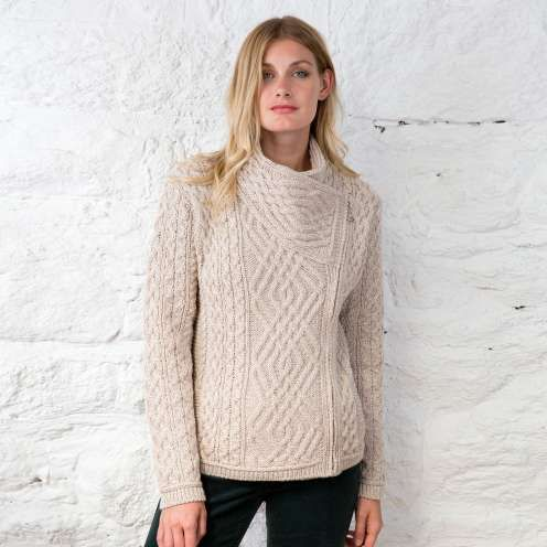 Taking its name from the stunningGenveaghnational park in County Donegal, this beautiful Aran cardigan showcases the best of traditional Irish craftsmanship with it's stunning Aran stitch patterns. The side fastening gives an unmistakably modern look and it's beautifully finished with a Trinity knot zipper to give a touch of Celtic flair. Made in County Mayo.