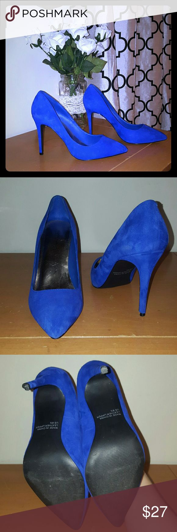 """Blue suede Pumps 4"""" single sole blue sude pumps. Heel tap on left shoe partially broken. Other than that in great condition. Genuine leather upper.  Fit true to size. Cathy Jean Shoes Heels"""