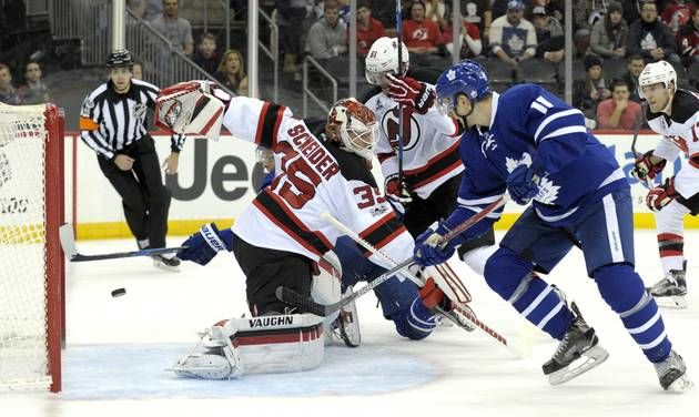 Red-hot Maple Leafs ride fast start to 4-2 win over Devils  -    Toronto Maple Leafs' Auston Matthews, rear, scores a goal behind New Jersey Devils goaltender Cory Schneider as Maple Leafs' Zach Hyman, right, looks on during the first period of an NHL hockey game Friday, Jan. 6, 2017, in Newark, N.J. (AP Photo/Bill Kostroun)