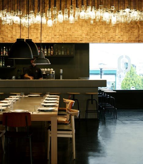 I love a good cluster of glass lighting fixtures. This is a barbeque restaurant, BarQue, in Athens designed by K-Studio.