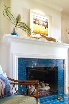 Having fun with detailed tile fireplace surround in beach blue and glass fire screen!