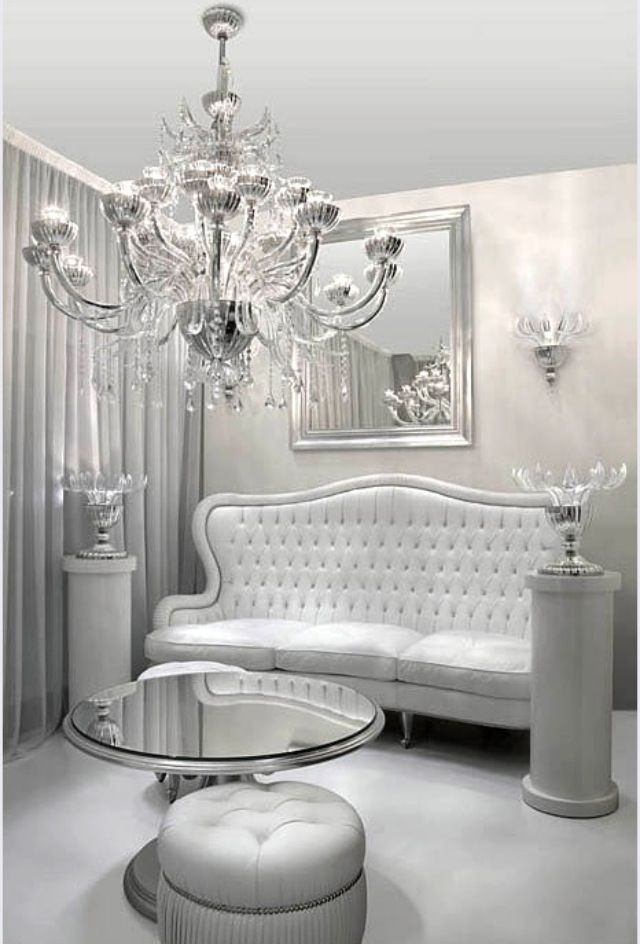 Lovely White And Silver Interior Very Elegant Chandelier Settee Below The Framed Mirror