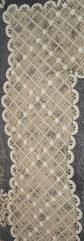 Intricate lattice border on a Japanese quilt at the 2011 Tokyo International Quilt Festival