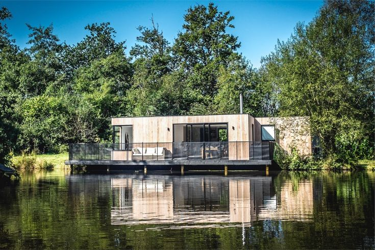 In 14 weeks, UK prefab and modular home builders Boutique Modern completed this off-the-grid lakeside home deep in Dorset's Hook Park Forest. The house draws water from the lake, and electricity is produced via solar panels and stored in a battery. Extra energy can be generated with a small diesel generator when needed.