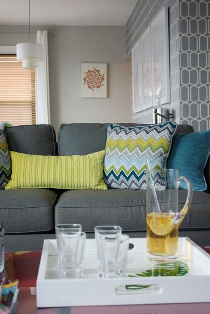Wallpaper and couch styling. I really love grey, yellow and turquoise together.