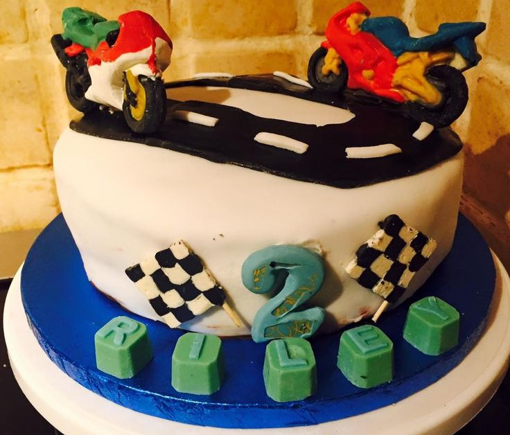 Birthday cake!! Motorbike, number 2 and letter blocks made from chocolate. Check out Ashleigh's chocolate delights on Facebook x #motorbikes #birthdaycake #caketoppers #chocolate