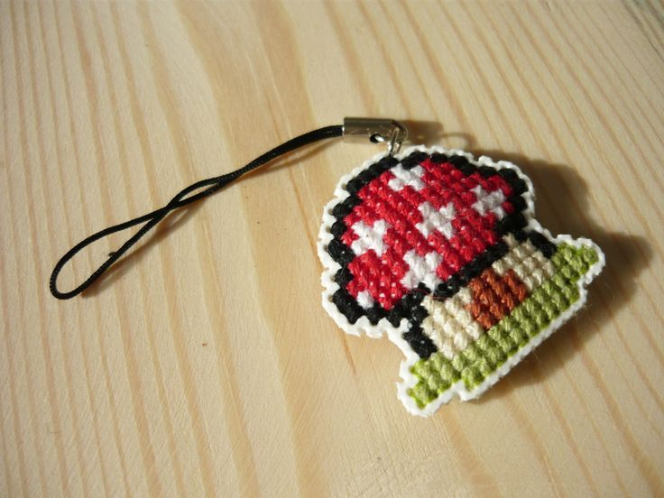 Cross stitch phone charm - Smurf house by MariAnnieArt on Etsy #MariAndAnnieArt #crossstitch #phonecharm #embroidered