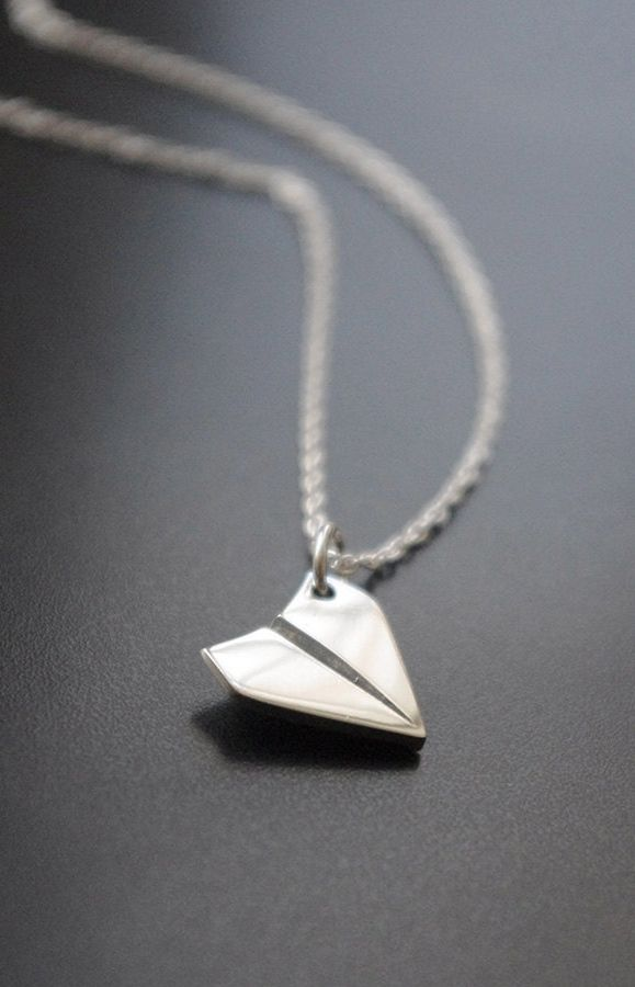 Paper Airplane Charm on a Necklace.  Reminds me of when I used to make these in class and then launch them at the end of the day.