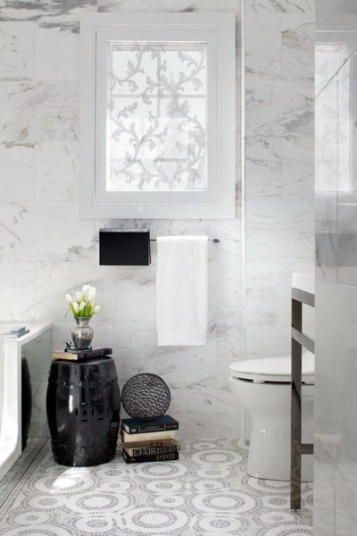 mosaic tile floor, marble tiled walls floor to ceiling, metallic black garden stool