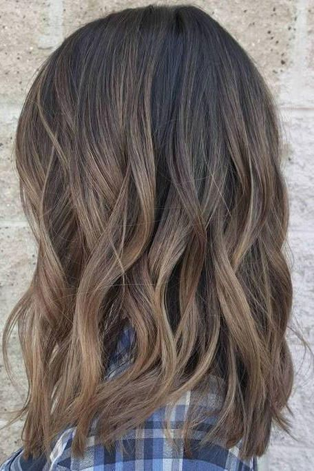 Ash Brown Balayage | Cool and earthy, this shade is surprisingly refreshing for spring and summer. When sunny and warm summer days are finally on the horizon, most Southern ladies are ready to freshen up their look with a new cut or color in anticipation. While your first instinct might be to match the weather with warm tones like gold, honey, caramel, and chestnut, we argue that the best approach to the changing season is the new cool-toned hair color trend taking over: mushroom brown hair.