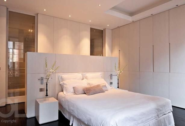clean simple contemporary bedroom suite with ensuite shower room set behind the bed and banks of fabulous wardrobes to one side. Great lighting too! Hélène et Olivier Lempereur - Architecte décorateur | Residential