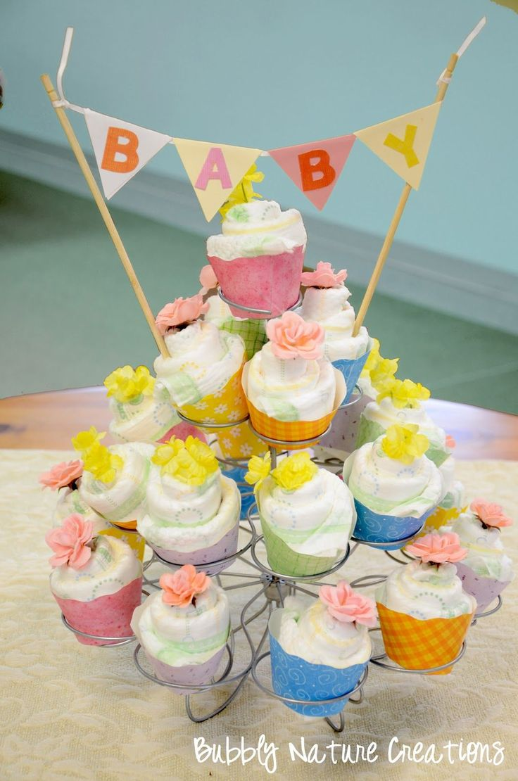 One of my favorite people in the world is having a little girl at the end of the month… so of course I had to make her something special… Diaper Cupcakes Tutorial These are so sweet a…