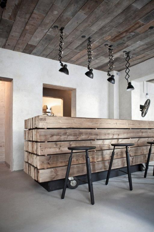 wooden bar and ceiling and industrial down lights