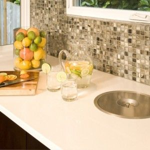 Midcentury Kitchen with White Countertop, Small Tiled Bascksplash, Stainless Steel Built in Compost Bin and White Trimmed Window