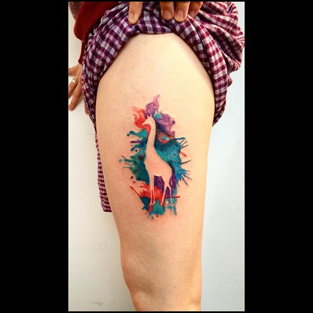 negative space watercolor giraffe tattoo