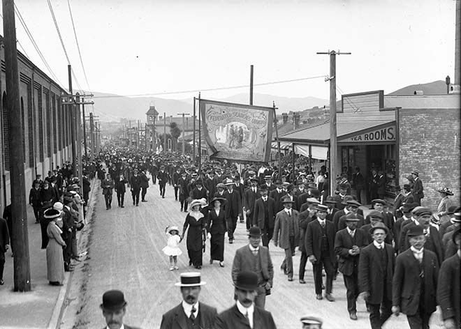 Unions were among the first groups to use art to convey a collective identity and seek public recognition and support. One medium for this was trade union banners, which union members took on public marches and events. Banners were often elaborate and finely detailed, depicting workers and symbols of the union. Here unionists march behind the Federated Seamen's Union banner in a march to Wellington's Newtown Park during the 1913 waterfront dispute. Zoom in for a detailed look at the banner.