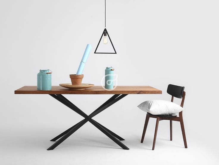 The triangle lamp and amazing, wooden table. We can change the lamp colour, so it can be colorful.