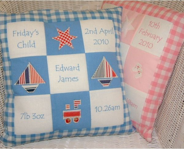 Also available in blue with appliqued boats, train and star.  This special cushion makes a truly unique gift for a new born baby.