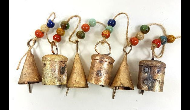 Mix of 6 different tiny bells with charming sound. Connected to a natural hemp sisal cord.  Decorated with colorful natural clay ceramic beads.   Handmade Indian small cow bells Every bell is...