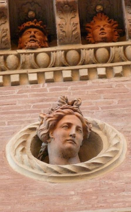 On the facade of a building in Piazza Santo Stefano, Bologna, Italy