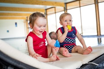 Cute shot of our models wearing the new designs from our best-selling Babywarma baby pool wetsuit range.