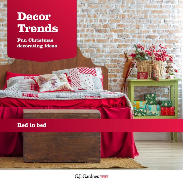 Create a Christmas bedroom with red throws, cushions and flowers.