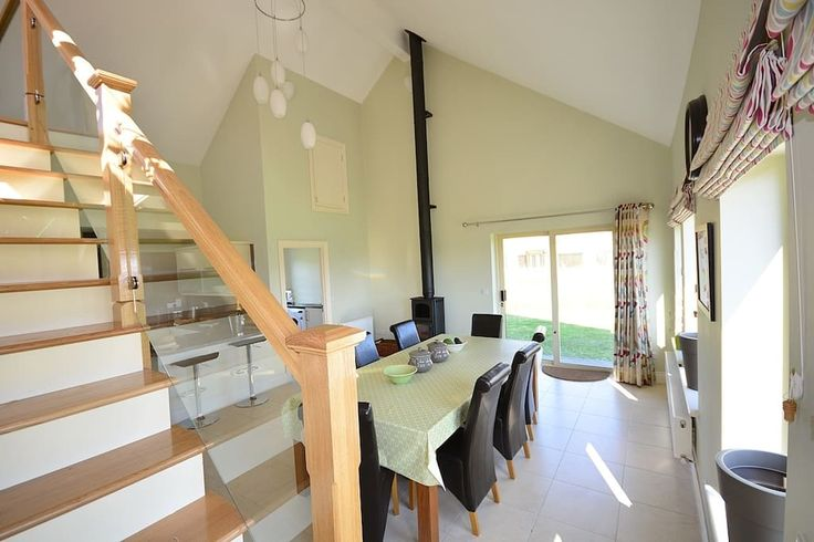 House in Dingle, Ireland. This stylish and welcoming new home is furnished to a high standard with a double height open plan kitchen/dining room, two lounges and four bedrooms. The cottage is cosy enough for a couple but would also comfortably accommodate two families.  Th...
