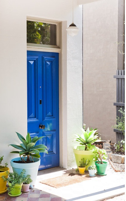 An eye-popping blue door with tropical accent colors gives this entryway maximum curb appeal. We recommend Kelly-Moore color Blue Bird Day KMA32 for a similar effect. http://www.colorstudiocollection.com