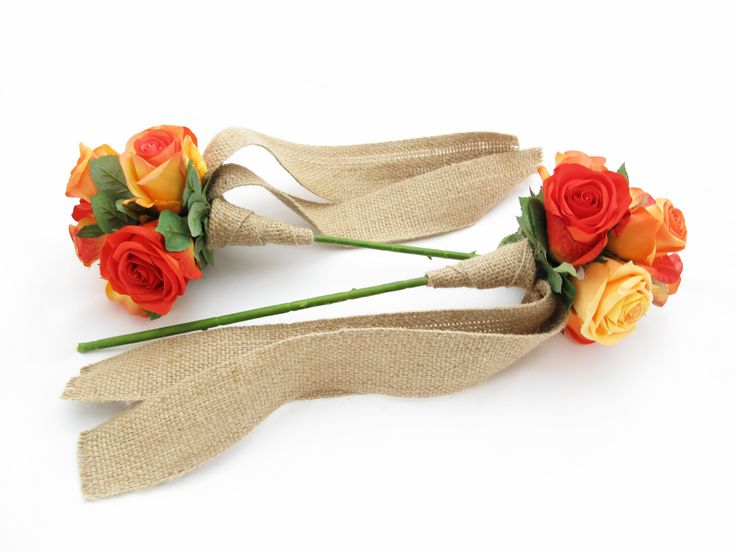 Flower wands of orange Garden Roses with hessian ribbons. Find your perfect wedding flowers at http://www.loveflowers.com.au/