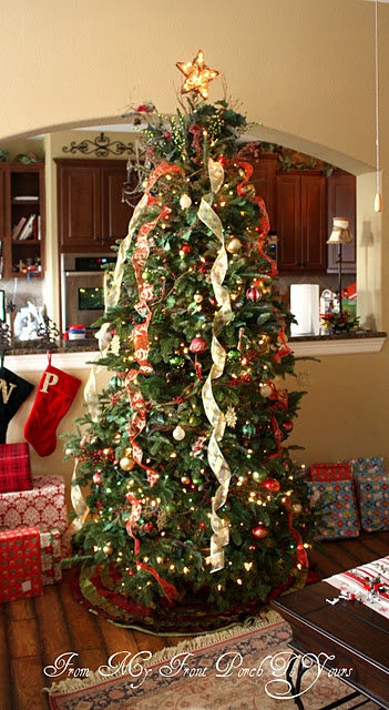 "Totally going for the ""cascading ribbon"" effect on the tree next Christmas instead of traditional garland!"