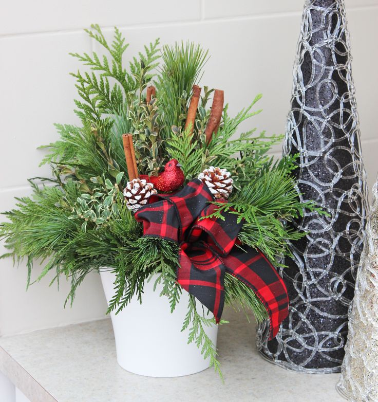 Indoor evergreen arrangement for the Christmas season