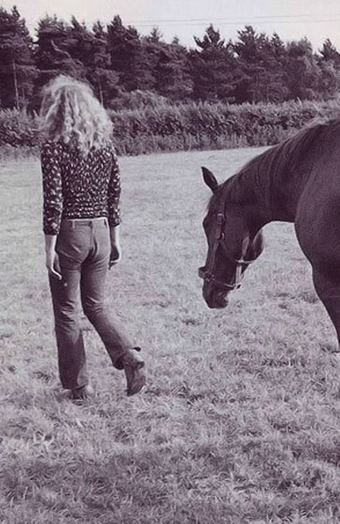 Robert Plant with his horse on his farm in England