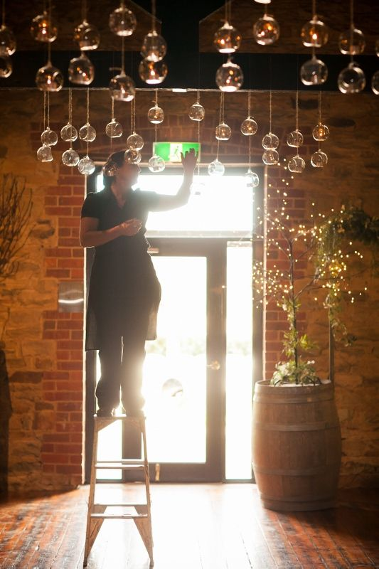 Lighting the tea lights in the Chapel Room - gorgeous for ceremonies @ Chateau Dore Winery