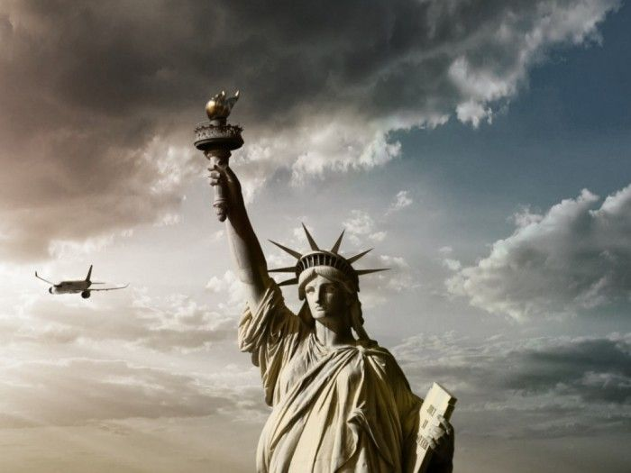 statue of liberty sunlight  http://www.topteny.com/top-10-countries-in-debt-shocking-results/