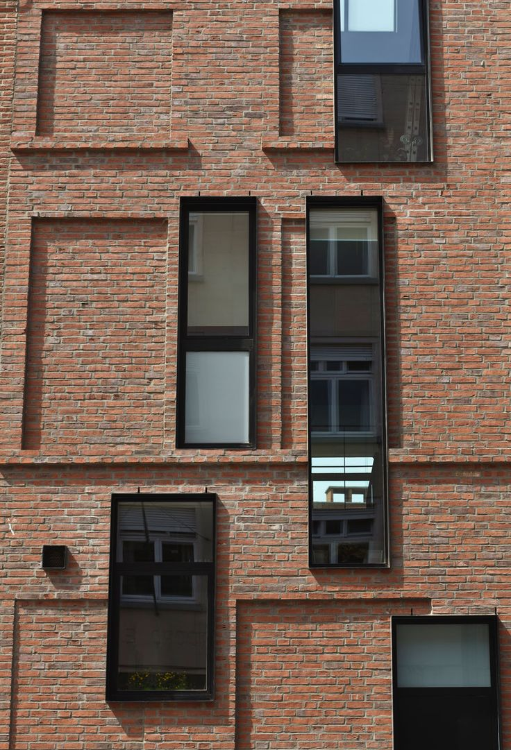 woning g-dc by lav-a Interesting juxtaposition of contemporary windows and blocked out existing windows
