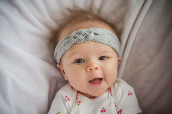 This heather gray cotton jersey knit headband is made for a baby, infant, toddler, or child. The fabric has a slight stretch so it will fit for a